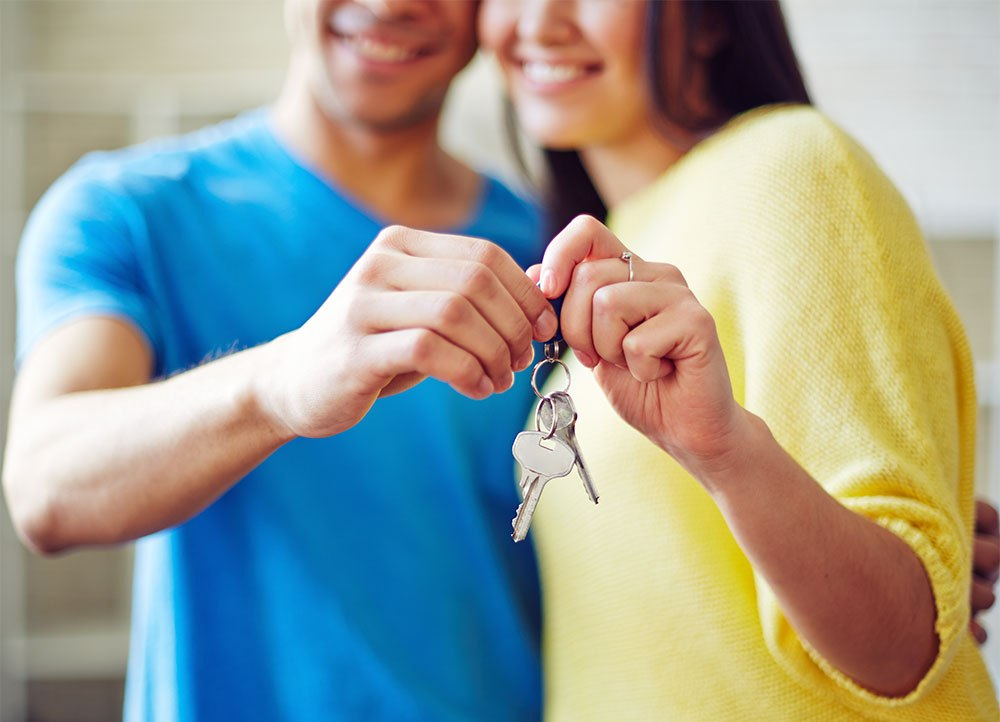 first-time-homebuyer-young-couple-showing-key-from-new-house.jpg
